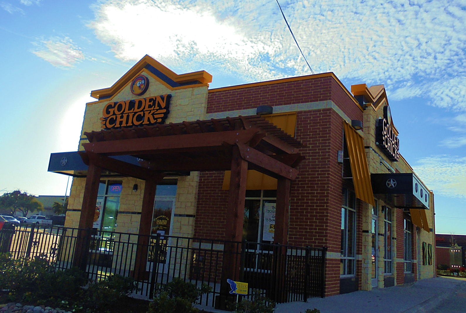 Golden Chick storefront.  Your local Golden Chick fast food restaurant in Carrollton, Texas
