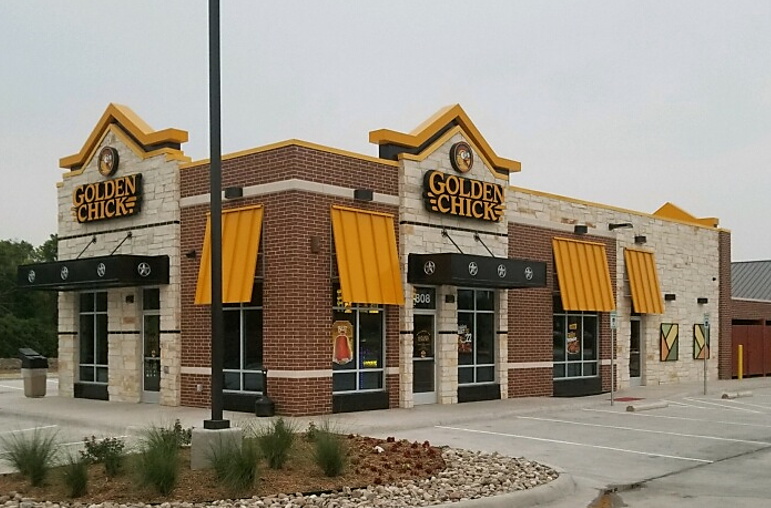 Golden Chick storefront.  Your local Golden Chick fast food restaurant in Plano, Texas